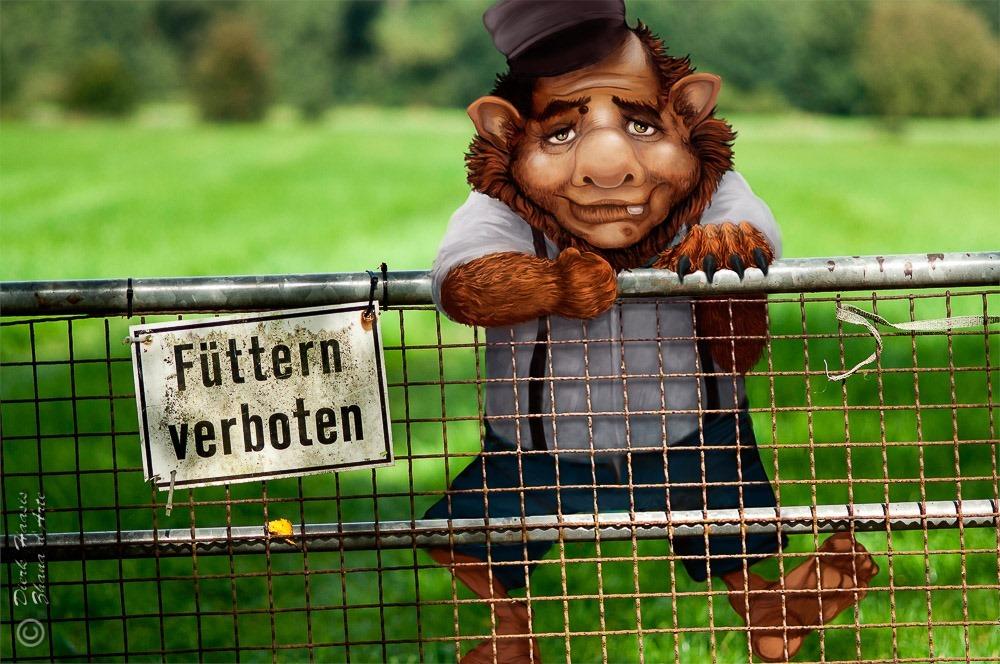 Hinter'm Zaun mit Schild 'Füttern verboten': Ein Troll
